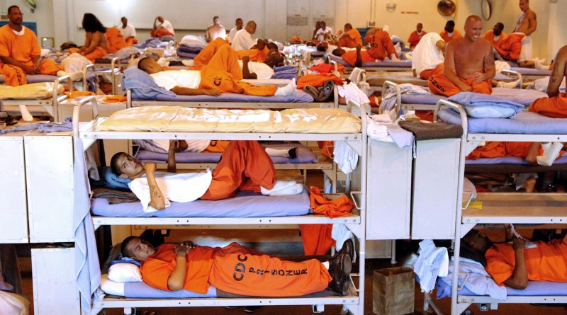 ** FILE ** In this undated file photo released by the California Department of Corrections, inmates sit in crowded conditions at California State Prison, Los Angeles. Their budgets in crisis, governors, legislators and prison officials across the nation are making or considering policy changes that will likely remove tens of thousands of offenders from prisons and parole supervision. In California, faced with a projected $42 billion deficit and severe prison overcrowding, Gov. Arnold Schwarzenegger has proposed the early release of up to 15,000 non-violent offenders and a reduction of about 70,000 in the state's parole population. (AP Photo/California Department of Corrections)