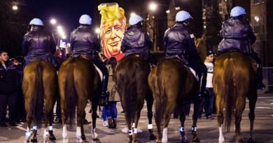 CHICAGO, IL - MARCH 11: Horses line up as protestors hold signs and celebrate outside after an event was postponed where republican presidential candidate Donald Trump was to speak at the University of Illinois at Chicago Pavillon in Chicago, IL on Friday March 11, 2016. (Photo by Jabin Botsford/The Washington Post via Getty Images)
