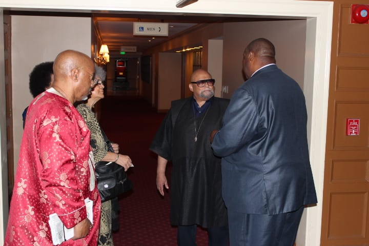 Dr. Maulana Karehga and Michael Reel chat following our interview. Photo Credit: Otis Mitchell/Reel Urban Images