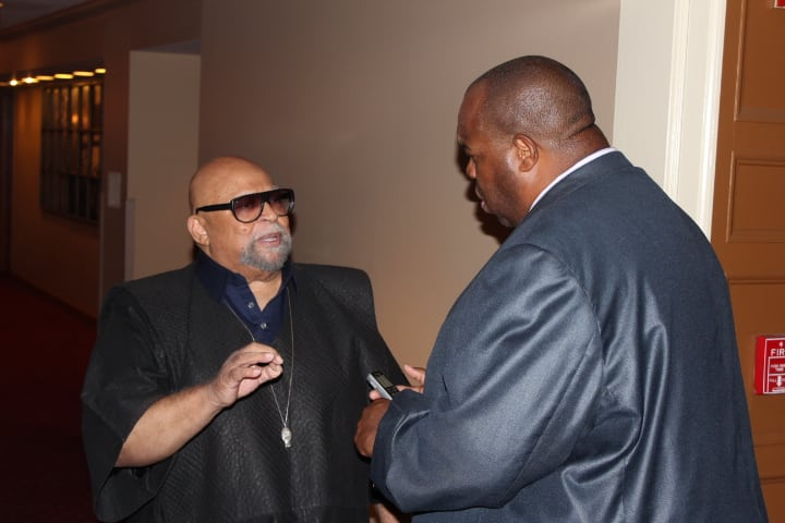 Dr. Maulana Karehga, Found of Kwanzaa being interviewed by Michael Reel, Reel Urban News. Photo Credit: Otis Mitchell/Reel Urban Images