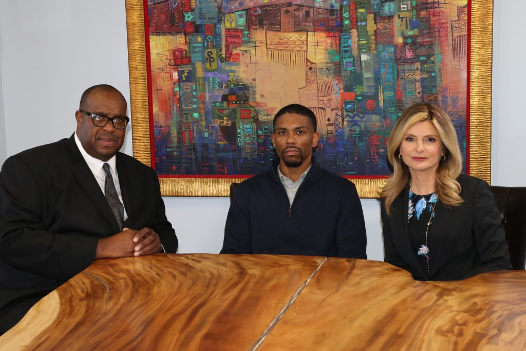 Isiah Washington (Center) appears with his attorney, Lisa Bloom and Michael Reel, Reel Urban News following recent interview. Photo: Reggie Simon, Reel Urban Images