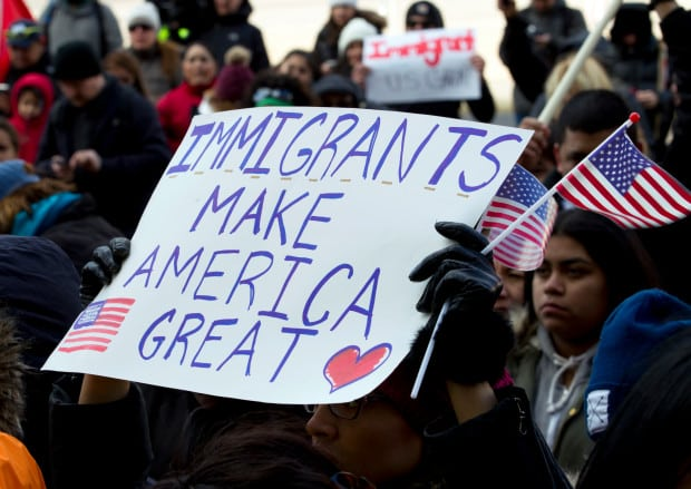Supporters of immigrants' rights march in downtown Washington during an immigration protest Thursday, Feb. 16, 2017, in Washington. Immigrants around the U.S. stayed home from work and school Thursday to demonstrate how important they are to America's economy, and many businesses closed in solidarity, in a nationwide protest called A Day Without Immigrants. (AP Photo/Jose Luis Magana)