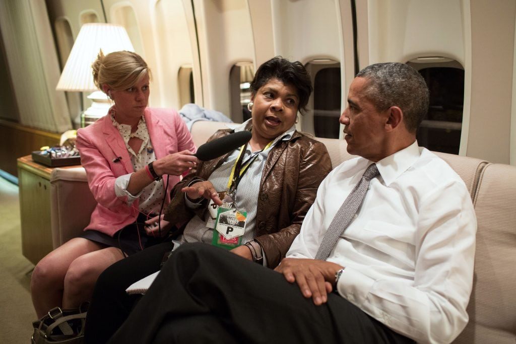 President Barack Obama is interviewed by April Ryan aboard Air Force One en route to Air Force Base Waterkloof in South Africa, June 28, 2013. (Official White House Photo by Pete Souza) This official White House photograph is being made available only for publication by news organizations and/or for personal use printing by the subject(s) of the photograph. The photograph may not be manipulated in any way and may not be used in commercial or political materials, advertisements, emails, products, promotions that in any way suggests approval or endorsement of the President, the First Family, or the White House.