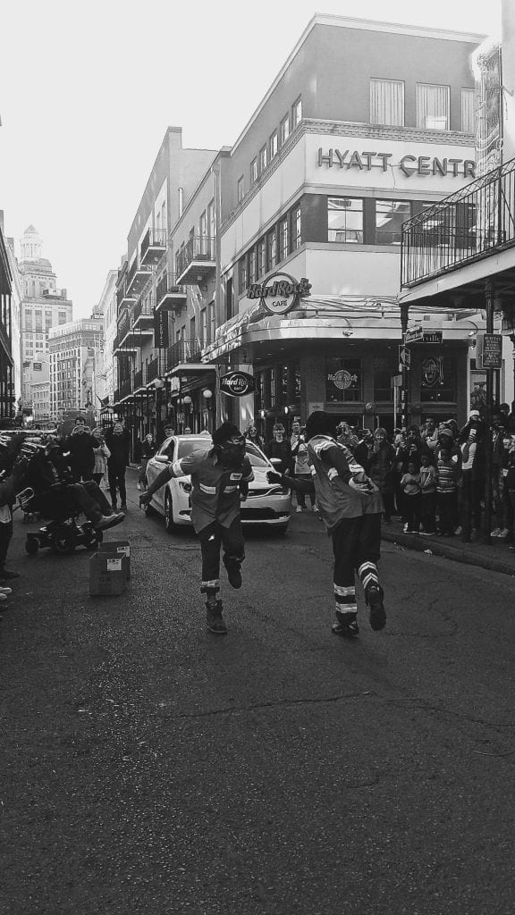 "Ramelli Waste workers dancing in the streets, ""French Quarter"" New Orleans, LA. Photo Credit: Alexander Phankaeo"