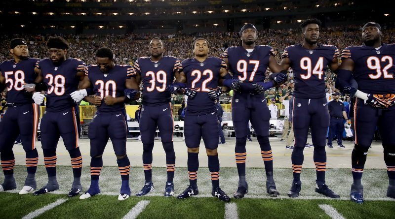 GREEN BAY, WI - SEPTEMBER 28:  Members of the Chicago Bears link arms during the singing of the national anthem before the game against the Green Bay Packers at Lambeau Field on September 28, 2017 in Green Bay, Wisconsin.  (Photo by Jonathan Daniel/Getty Images)