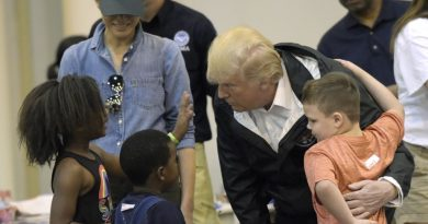 President Donald Trump and Melania Trump meet people impacted by Hurricane Harvey during a visit to the NRG Center in Houston, Saturday, Sept. 2, 2017. The Trumps will also make a stop in Lake Charles, La., to meet with people at an emergency operations center. (AP Photo/Susan Walsh)